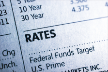 Image: Section of newspaper showing the Federal Funds target rate, U.S. Prime rate, and various interest rates.